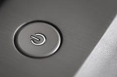 Fotografía macra de un botón de plata de la potencia Imagen de archivo libre de regalías
