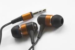 Fotografía macra del auriculares estéreos Fotos de archivo libres de regalías