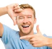 Fotografía que enmarca del hombre feliz Imagen de archivo libre de regalías