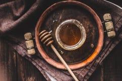 Fotografía rústica de la miel, anuncio de la comida Foto de archivo