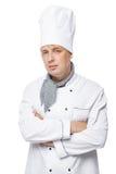 fotografía vertical del cocinero de 30 años en un blanco Imagen de archivo libre de regalías
