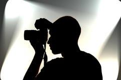 Fotograf auf Arbeit lizenzfreie stockbilder