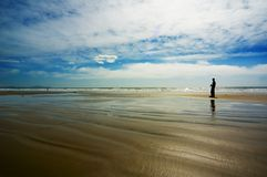 Fotograf auf dem Strand Stockfoto