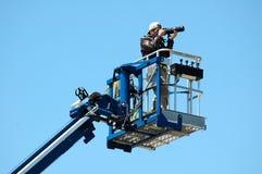 Fotograf auf einem Hochkonjunktur-Dock Stockbilder