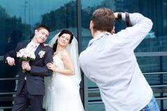 Fotograf in der Aktion Stockbild