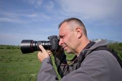 Fotograf in der Aktion Stockfoto