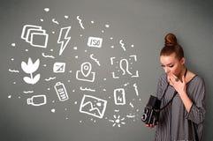 Fotograf dziewczyna chwyta białych fotografia symbole i ikony Zdjęcia Royalty Free