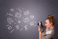 Fotograf dziewczyny fotografii mknące ikony Fotografia Stock