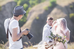 Fotograf i handling Arkivfoto
