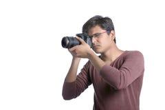 Fotograf med kameran Fotografering för Bildbyråer