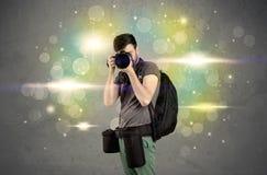 Fotograf mit Blinklichtern Lizenzfreies Stockbild