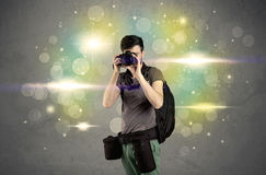 Fotograf mit Blinklichtern Lizenzfreie Stockfotografie
