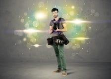 Fotograf mit Blinklichtern Stockfotografie