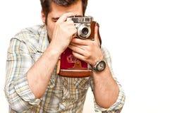 Fotograf mit einer Weinlesekamera Stockfotos