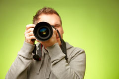 Fotograf mit Kamera Stockfotografie