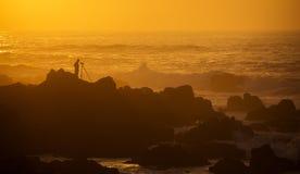 Fotograf på solnedgången Royaltyfri Fotografi