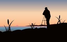 Fotograf på solnedgången Arkivfoto