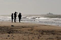 Fotograf på stranden Arkivbild