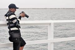 Fotograf przy molem Obrazy Royalty Free