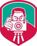 Fotograf Shooting Camera Shield Retro- Lizenzfreie Stockfotos