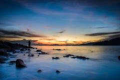 Fotograf siluate, Sonnenuntergang auf dem Strand Stockbild
