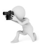 Fotograf som använder kameran Arkivfoton
