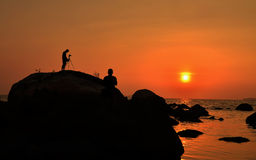 Fotograf und Sonnenuntergang Lanscapher Stockfotografie