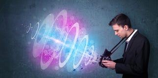 Fotografdanandefoto med den kraftiga ljusa strålen Royaltyfri Fotografi