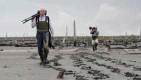 Fotografen auf einem Sumpf. Lizenzfreie Stockfotos