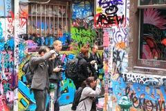Fotografer i hosieren Lane Melbourne royaltyfri fotografi