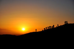 Fotografer och soluppgång Fotografering för Bildbyråer