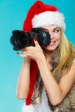 Fotografflicka i bilder för Santa Claus hattskytte Royaltyfria Bilder