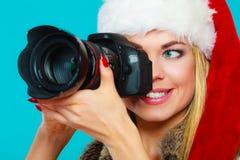 Fotografflicka i bilder för Santa Claus hattskytte Royaltyfri Foto