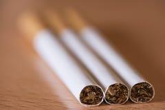 Fotografi av tre cigarrer Arkivbild