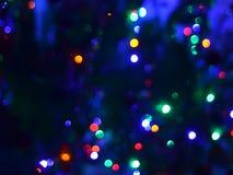 Fotografi för bakgrund för ljus för bokeh för defocus Abstact för mörk natt blury Arkivfoton