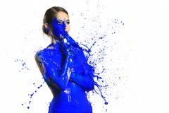 Fotografia ad alta velocità della donna con pittura liquida Fotografie Stock