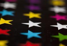 Fotografia barwione gwiazdy n czerń Obrazy Royalty Free