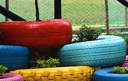 Fotografia Colourful del fondo dei pneumatici Immagini Stock