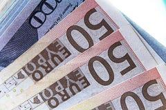 Fotografia conservada em estoque com três contas por 50 euro no primeiro plano Imagens de Stock Royalty Free