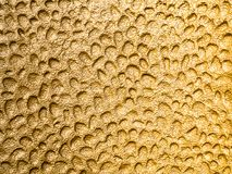 Fotografia do fundo do metal derretido no ouro Foto de Stock