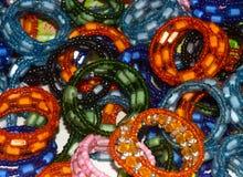 Fotografia fêmea do fundo dos braceletes Fotografia de Stock Royalty Free