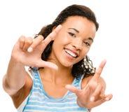 Fotografia felice dell'inquadratura della donna della corsa mista isolata sulla parte posteriore di bianco Fotografia Stock Libera da Diritti