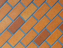 Fotografia pavimentada do fundo do tijolo, marrom vitrificado na inclinação da diagonal imagem de stock