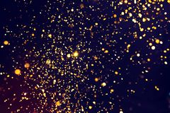 Fotografia złota błyskotliwość na czarnym tle złoty eksplozję Obrazy Royalty Free