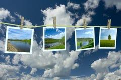 Fotografias da paisagem que penduram em um clothesline Foto de Stock Royalty Free