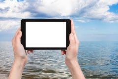 fotografias do turista do mar de Azov no PC da tabuleta Fotografia de Stock Royalty Free