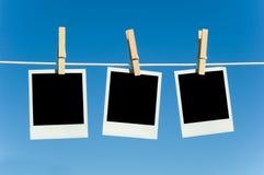 Fotografias em um clotheline Fotografia de Stock