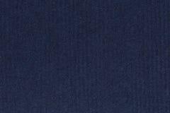 Fotografiet av mörker, djupt marinblått återanvänder randigt papper, extrahjälp Arkivfoto