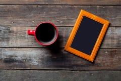 Fotografii filiżanka kawy i rama Zdjęcia Stock