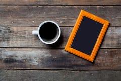 Fotografii filiżanka kawy i rama Fotografia Royalty Free